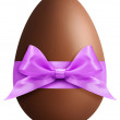 Easter chocolate egg with purple ribbon bow — Stock Photo #68176101