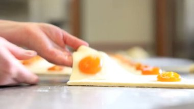 Hands pastry chef work croissants — Stock Video