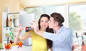 Smiling couple make a selfie in coffee bar — Stock Photo