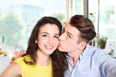 Smiling young couple who do a selfie — Stock Photo
