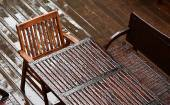 Wet table with chairs after the rain — Stock Photo