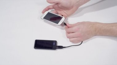Charging smartphone with solar cell phone charger — Stock Video