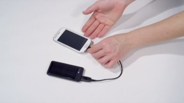 Unplugging smartphone off the solar charger — Stock Video