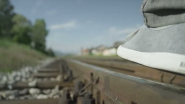Man walking on railroad track — Stock Video