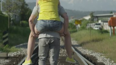 Piggyback ride on a railroad — Stock Video