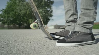 Skateboarder picking up his skate — Stock Video