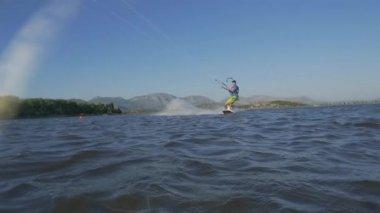 Kiteboarder jumping backroll trick — Stock Video