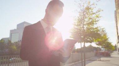Businessman browsing on his digital tablet — Stock Video