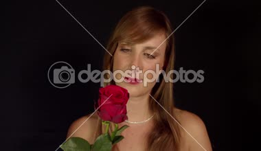 Topless woman smelling red rose — Vídeo de Stock