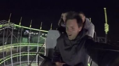 Friends on a roller coaster ride — Stock Video