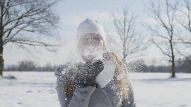 Woman blowing snow kiss — Stockvideo