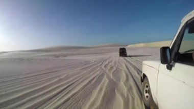 Off road jeeps driving through desert — Stock Video