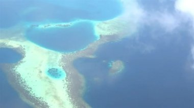 Flying above exotic white sand atoll — Stock Video