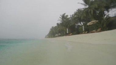 Heavy rainfall on tropical beach — Stock Video