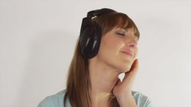 Woman with headphones swaying to romantic music — Stock Video