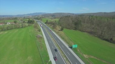 AERIAL: Cars and trucks speeding on the highway — Stock Video