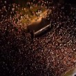 AERIAL: Crowd of people dancing on a music festival — Stock Video #78567684