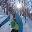 SELFIE: Snowboarder riding powder snow in sunny winter — Stock Video #78568730