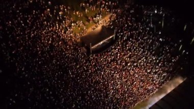 AERIAL: Crowd of people dancing on a music festival — Stock Video