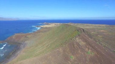 AERIAL: Flying over the top of extinct volcano — Stock Video