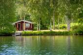 Cottage by the lake in rural Finland — Stock Photo