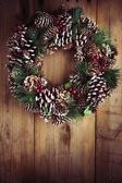 Christmas wreath on a rustic wooden door — Stock Photo