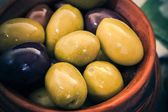 Mix of organic olives in a bowl — Stock Photo