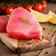 Raw tuna fillet with dill, lemon and cherry tomatoes — Stock Photo #65498875