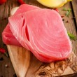 Raw tuna fillet with dill, lemon, cherry tomatoes and olive oil — Stock Photo #65499013