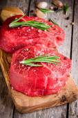 Two raw steaks with rosemary, garlic, salt and pepper — Stock Photo