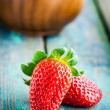 Fresh ripe organic strawberries in a wooden bowl closeup — Stock Photo #71768051