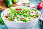 Potato salad with fresh radishes in a white bowl  with dill and green onion — Stock Photo