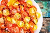Salad of organic cherry tomatoes with olive oil and balsamic sauce closeup — Stock Photo