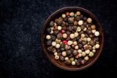 Peppercorns in a wooden bowl — Stock Photo