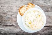 Homemade soup with salmon and cream with croutons — Stock Photo