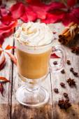 Pumpkin latte with whipped cream in a glass jar — Stock Photo