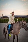 Woman on a horse — Stock Photo
