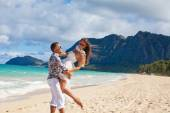 Happy young couple in love on the beach of sea — Stock Photo