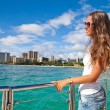 Happy young woman relaxing on yacht — Stock Photo #67730367