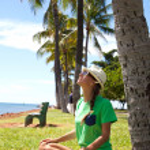 Woman doing yoga exercises on the beach — Stock Photo #70937859