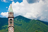 The bell tower that stands in the mountains — Stock Photo