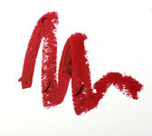 Red color lipstick stroke on white paper — Stock fotografie