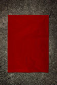 Red paper on cement wall — Stock Photo