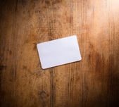 Blank card on wooden table — Photo