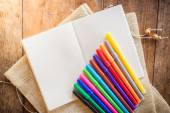 Blank notebook with many color markers — Stock Photo