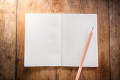 Blank notebook with pencil — Stock Photo