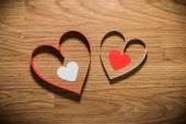 Red and white heart on a wooden background — Stock Photo