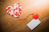 Valentine's paper heart with a blank business card — Stock Photo