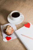 Chocolate muffin and coffee and hearts on sackcloth textures — Stock Photo