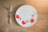 Valentines day dinner with table setting — Stock Photo